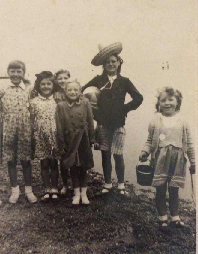 Mum and friends (that's her best friend Yvonne at the front) at the beach circa 1945